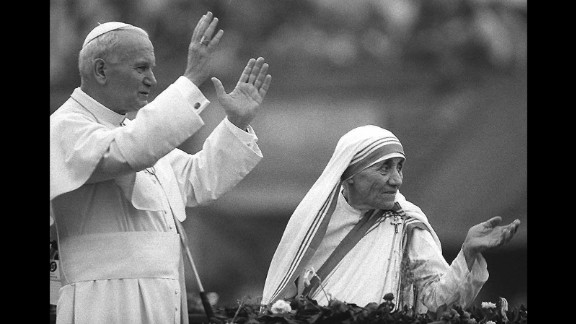 Pope John Paul II and Mother Teresa wave to well-wishers in Calcutta on February 3, 1986.