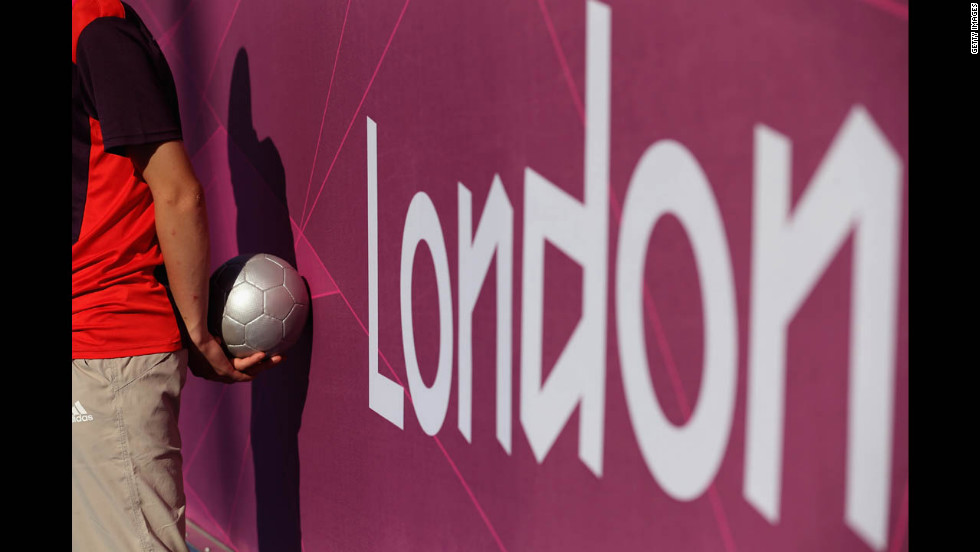 A volunteer holds a ball during the soccer match between Great Britain and Turkey on Saturday.
