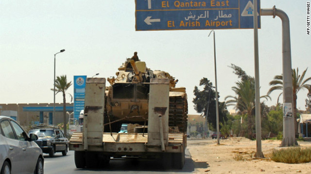 Egyptian tanks are carried on the back of trucks on the Egyptian side of the border city of Rafah on August 29.