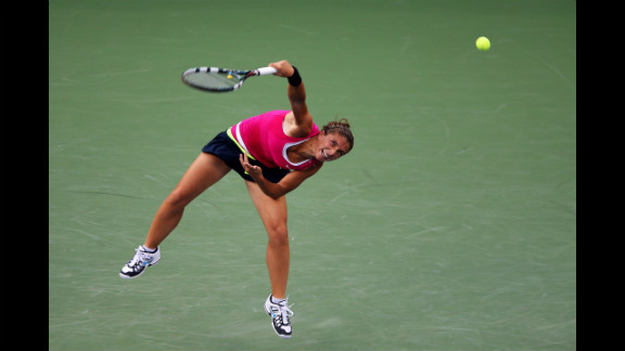 Sarah Errani of Italy serves in her match against Serena Williams of the United States during a women