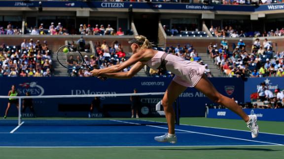 Sharapova returns a shot against  Azarenka on Friday.