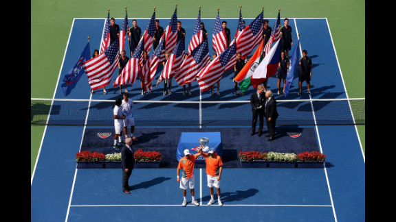 Bob Bryan and Mike Bryan of the United States pose with their trophy after their men