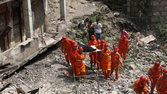Rescuers remove a body of a victim on Saturday. The southwestern region of China is prone to earthquakes. In May 2008, a magnitude 7.9 quake in Sichuan province caused widespread devastation, killing at least 69,000 people.