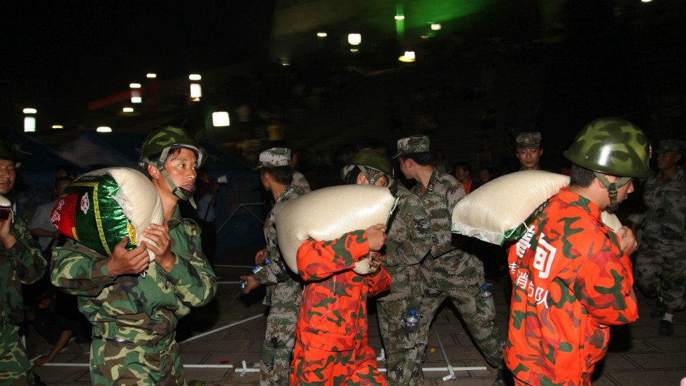Rescuers unload supplies at an emergency relief center in Yiliang on September 8.