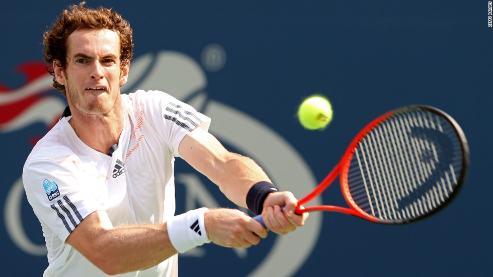 British Andy Murray returns a shot against Czech Tomas Berdych during his men's singles semifinal match in the 2012 U.S. Open on Saturday, September 8.