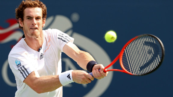 British Andy Murray returns a shot against Czech Tomas Berdych during his men