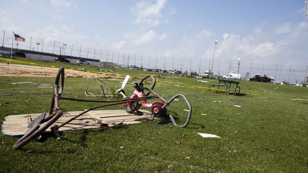 A baseball field is filled with debris from the tornado, which started as a waterspout and came ashore.
