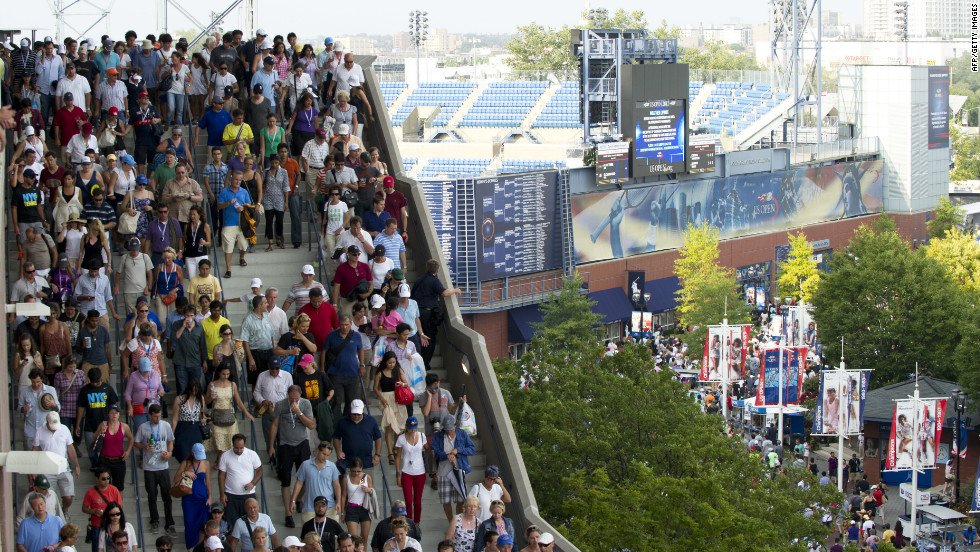 Spectators evacuate the Arthur Ashe Stadium during a semifinal match at the U.S. Open due to severe weather in the area.
