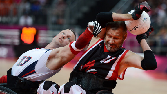 No. 13 Derrick Helton of the United States attempts to get the ball from No. 13 Jared Funk  of Canada during Saturday