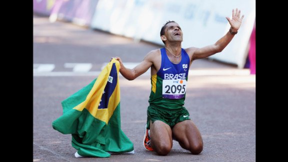 Tito Sena of Brazil celebrates winning the men's T46 marathon on Sunday, September 9, the final day of the London 2012 Paralympics.