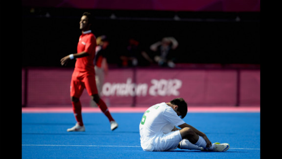 Mateus Francisco Tostes Calvo of Brazil, in white, sits on the field after losing to Iran 5-0 in the men
