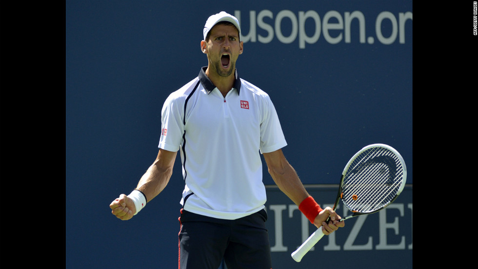 Djokovic reacts to winning a point against Ferrer during the match Sunday.