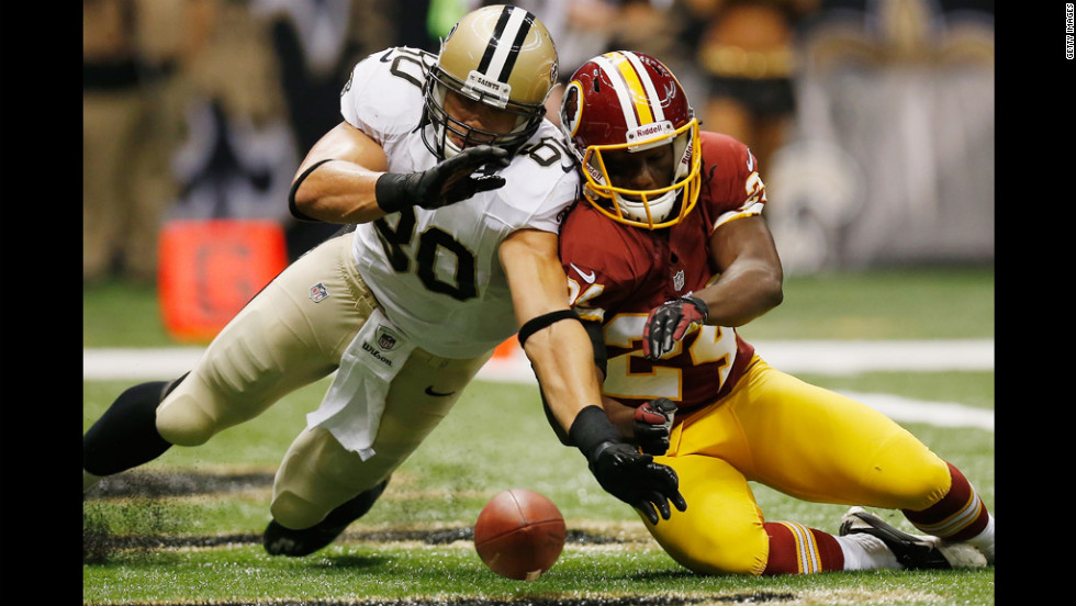 No. 80 Jimmy Graham of the Saints fights for a fumble with No. 24 DeJon Gomes of the Redskins on Sunday.