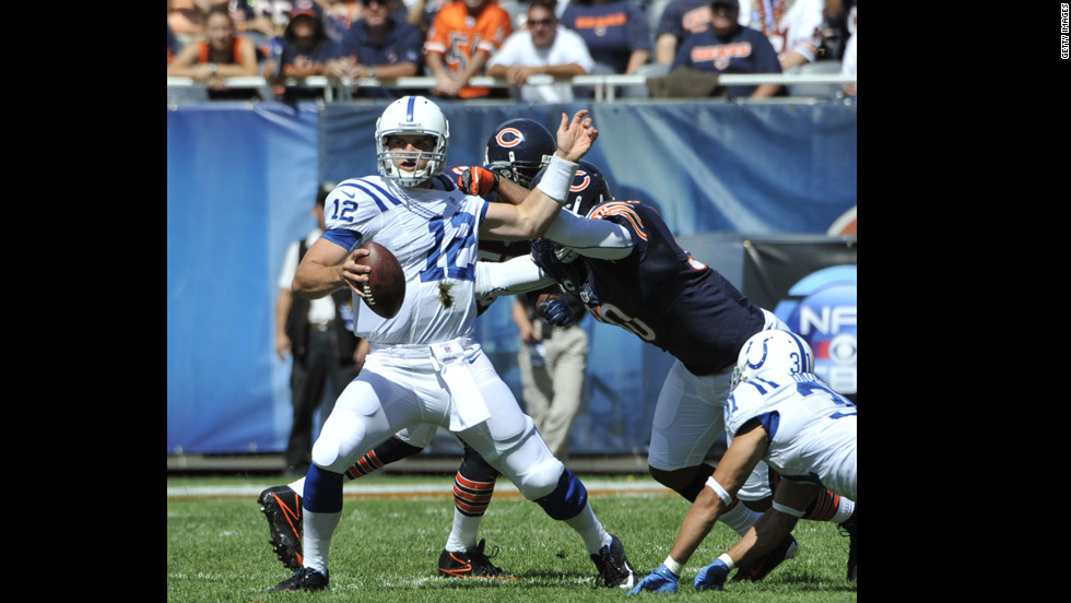 No.12 quarterback Andrew Luck of the Indianapolis Colts is grabbed by No. 90 Julius Peppers of the Chicago Bears on Sunday.