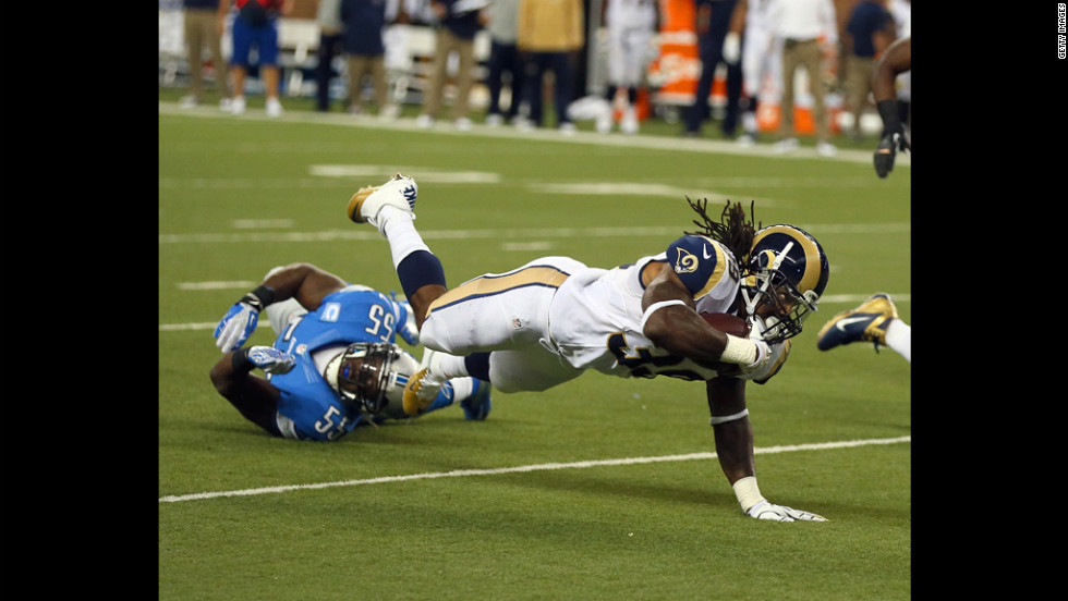 In Detroit on Sunday, No.39 Steven Jackson of the St. Louis Rams is tripped up by No.55 Stephen Tulloch of the Detroit Lions.