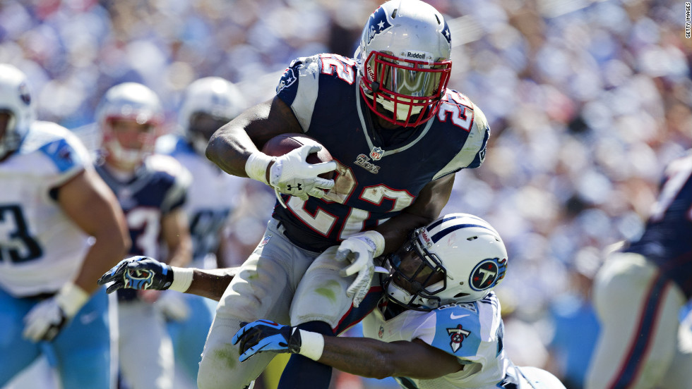 No. 22 Stevan Ridley of the Patriots is tackled by No. 32 Robert Johnson of the Titans.