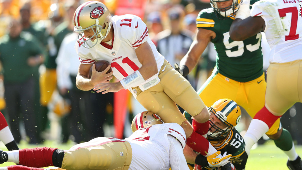 No. 11 Alex Smith of the 49ers is sacked by No. 52 Clay Matthews of the Packers on Sunday.
