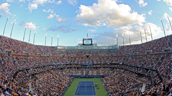 Spectators in a packed Arthur Ashe Stadium watch the women