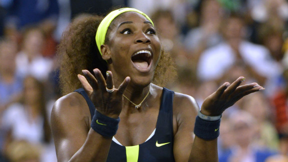 Serena Williams of the United States celebrates defeating Victoria Azarenka of Belarus 6-2, 2-6, 7-5 in the 2012 U.S. Open women