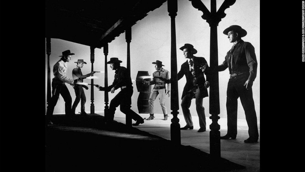 "Six TV Western heroes, who never trade fire on screen because they are all in different weekly serials, stage a mock battle symbolic of a ratings war. From left, Clint Walker, ""Cheyenne""; Jim Arness, ""Gunsmoke""; Dick Boone, ""Have Gun, WIll Travel""; Robert Horton, ""Wagon Train""; James Garner, ""Maverick""; John Payne, ""Restless Gun."""