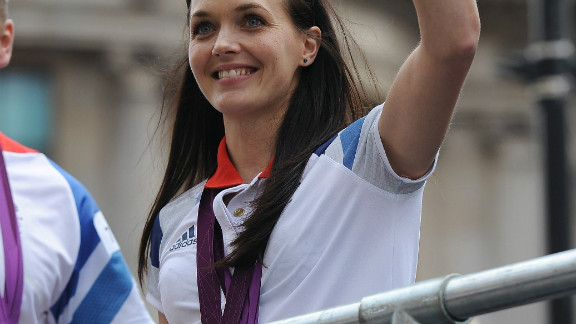 Cyclist Victoria Pendleton waves to the fans after winning both a gold and a silver medal at the Olympics.