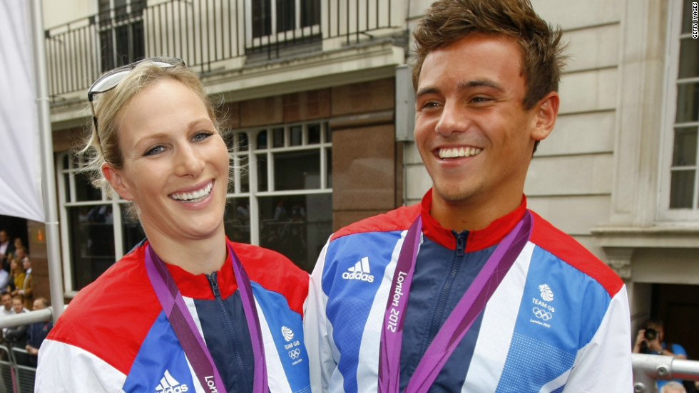 Equestrian athlete Zara Phillips smiles for the camera with her Olympic Three Day Event silver medal alongside Olympic diver Tom Daley.