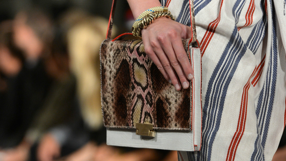 Iconic American designer Tommy Hilfiger's line showcases nautical themes with snakeskin accessories.