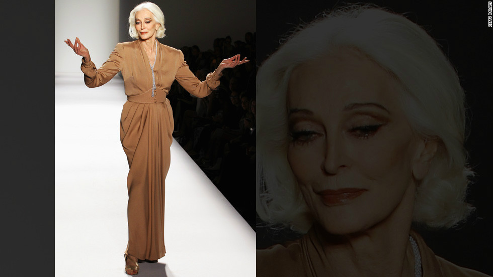 At 81, Carmen Dell'Orefice walks the Norisol Ferrari fashion show, proving you're only as old as you feel.