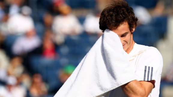 Andy Murray of Great Britain wipes his face with a towel during his men