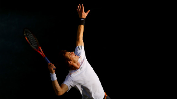 Andy Murray serves during his men