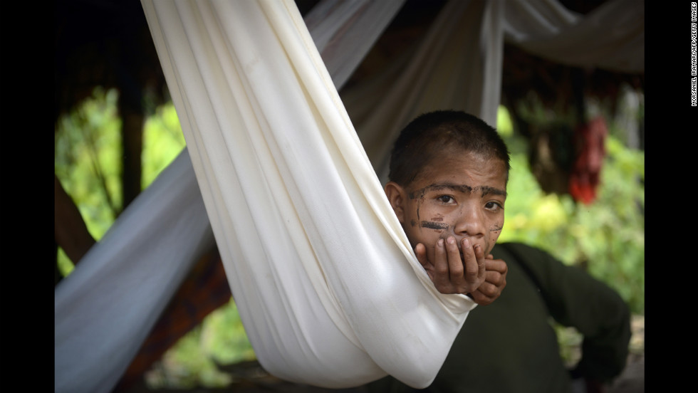 A Yanomami boy rests in a hammock.