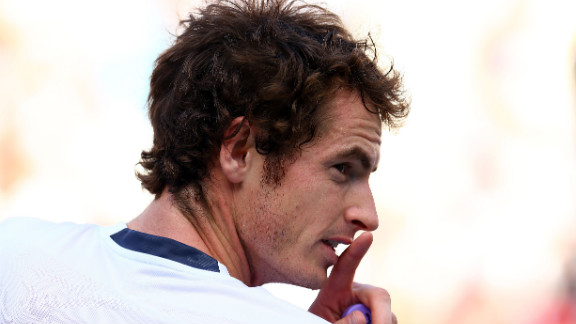 Andy Murray looks on during a break in his men