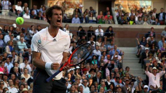 Andy Murray of Great Britain celebrates getting set point after the first set during his men