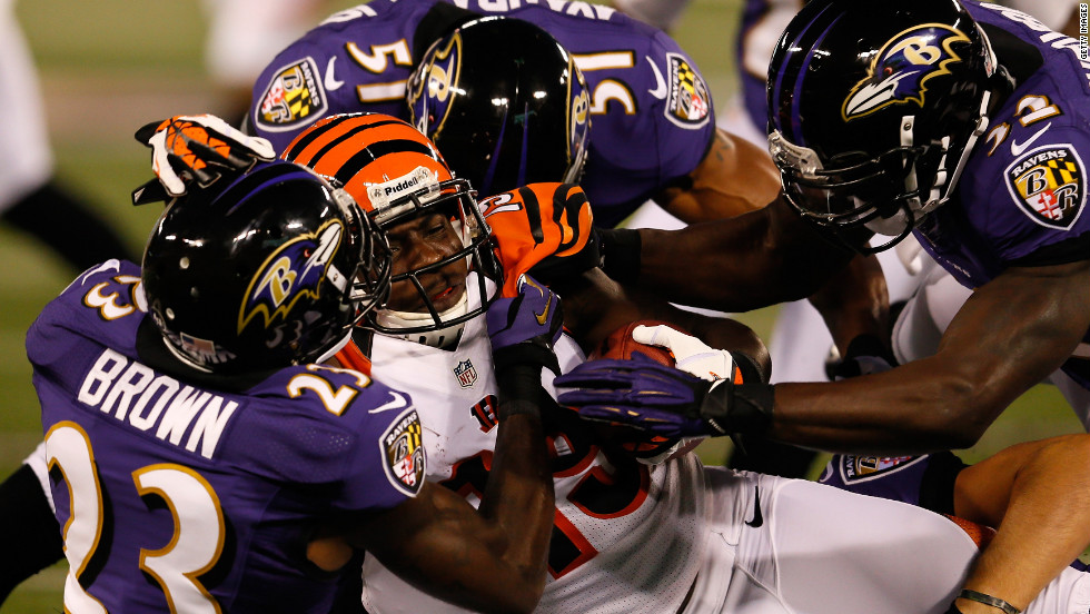 Wide receiver Brandon Tate of the Cincinnati Bengals is hit by defensive back Chykie Brown and linebacker Brendon Ayanbadejo of the Baltimore Ravens after a return in the first half on Monday, September 10.