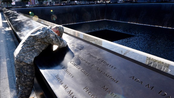 Scott Willens, who joined the U.S. Army three days after the terrorist attacks of 9/11, pauses at the South Pool of the 9/11 Memorial on Tuesday.