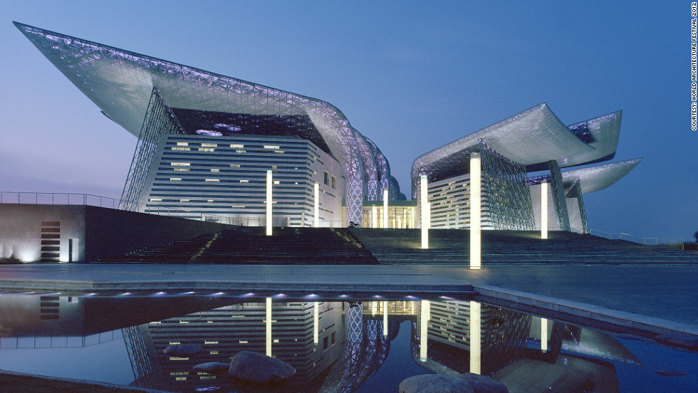 Built on the man-made peninsula of Taihi Lake in China, the Wuxi Grand Theatre was designed to have the appearance of a sculpture rising from the sea. Adding a touch of drama, the steel wings are dotted with thousands of LED lights that change color according to the character of the performances.<br /><em>Designed by: PES-Architects, Finland</em>