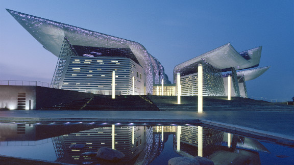 Built on the man-made peninsula of Taihi Lake in China, the Wuxi Grand Theatre was designed to have the appearance of a sculpture rising from the sea. Adding a touch of drama, the steel wings are dotted with thousands of LED lights that change color according to the character of the performances. Designed by: PES-Architects, Finland