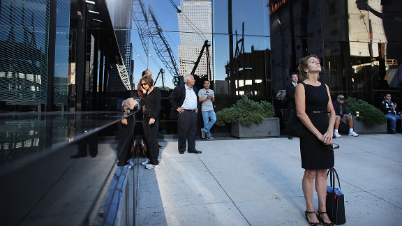 New Yorkers pause near the World Trade Center site on Tuesday.