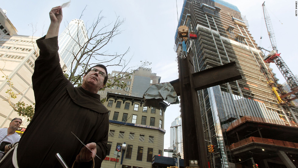 Father Brian Jordan prepares to conduct a blessing of the cross before it was moved into its permanent home in the 9/11 Memorial Museum in New York City on July 23, 2011.