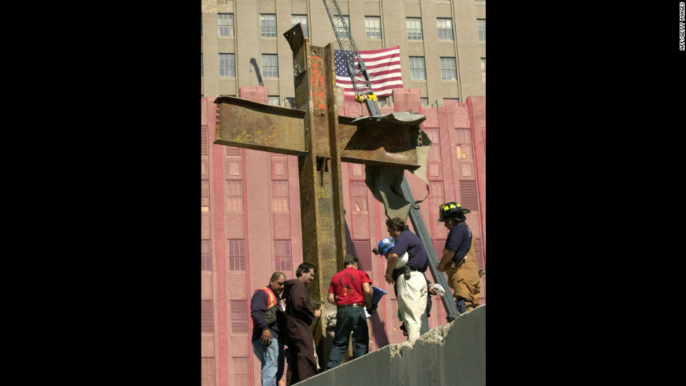 Jordan, second from left, blesses the cross on October 4, 2001.