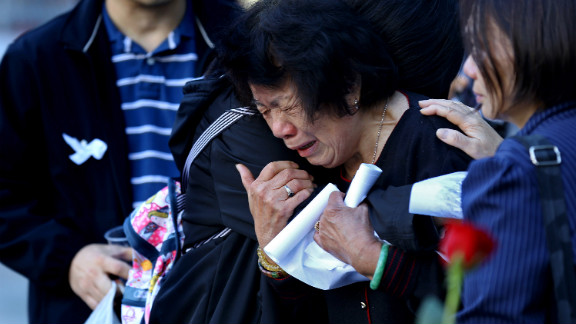 A woman cries during the rememberance ceremonies at the World Trade Center site in New York on Tuesday.