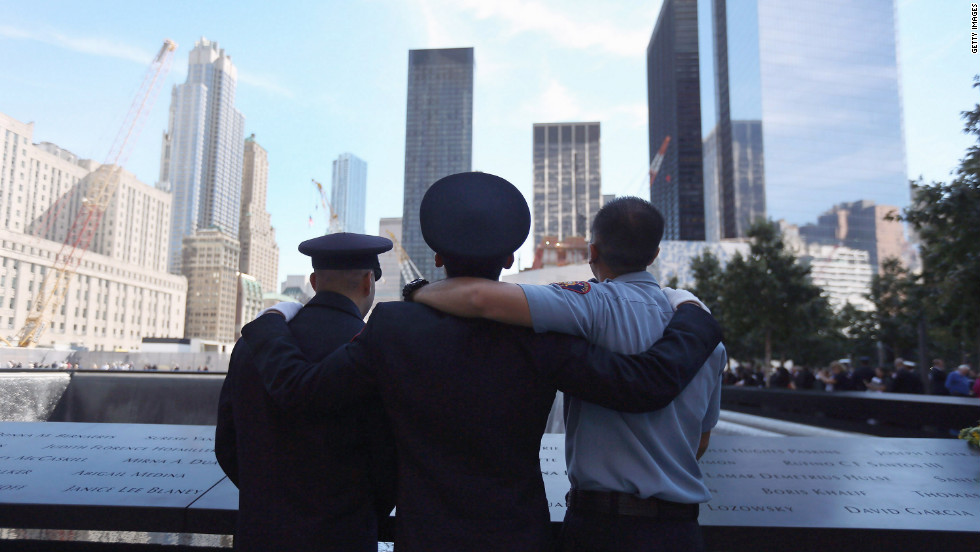 Fire fighters pay their respects at the 9/11 Memorial during ceremonies on Tuesday.