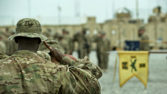 U.S. military platoons operating out of Lindsey-Forward Operating Base in Afghanistan stand in formation Tuesday during a brief ceremony.
