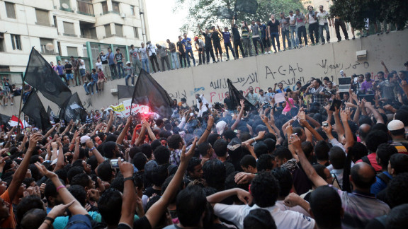 Protesters gather along the U.S. Embassy wall. Photos: Attack on the U.S. Consulate in Libya kills four or see more of CNN