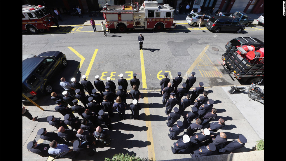 The firefighters of New York City's Engine 33-Ladder 9 observe a moment of silence on Tuesday.  The company lost 10 firefighters in the 9/11 attacks.