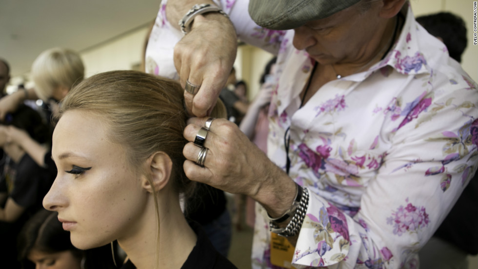 "At New York Fashion Week this month, stylists walked CNN through how to get the 1960s-inspired look from Pamella Roland's spring/summer 2013 show. Mimic this classic chignon and cat eye, and you'll look like a star from the runway or the red carpet. Hairstylist Paul Labrecque describes the look: ""Models' hair will be slightly teased, pulled into a chignon and then sprayed with a high-gloss finish."""