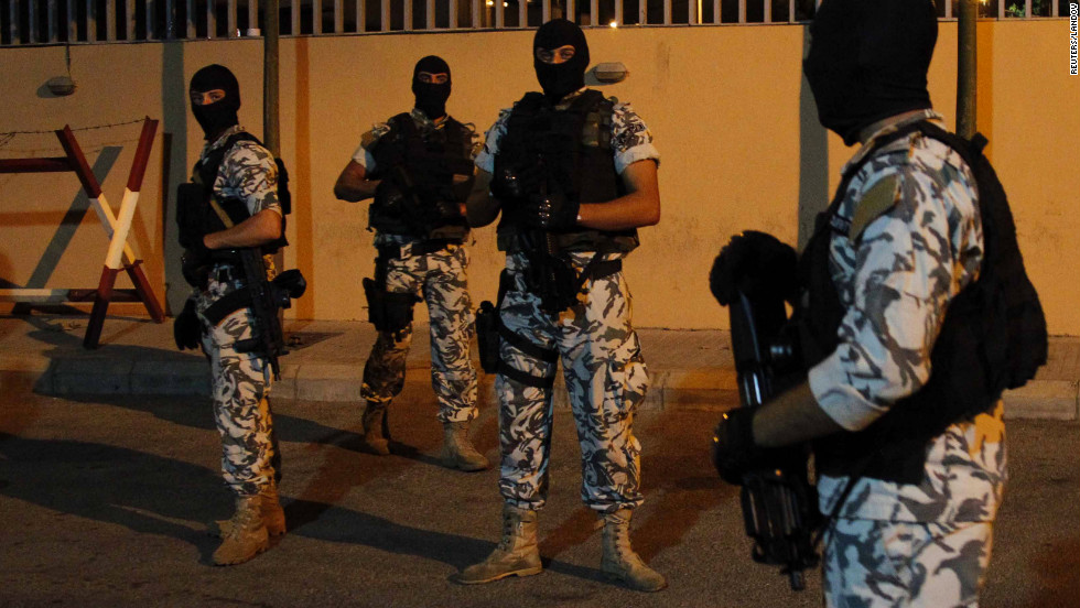 Members of Lebanese security forces stand guard after escorting the newly released Aydin Tufan Tekin, a Turkish national abducted by a Lebanese Shiite clan in Beirut, to the Lebanese General Security in Beirut, on Tuesday, September 11. The hostage was a Turkish businessman abducted in mid-August, along with around 20 Syrians, to put pressure on rebels in Syria who had seized one of their kinsmen in Damascus.