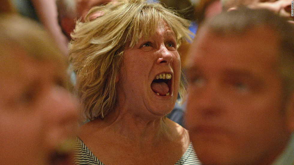 A fan of tennis player Andy Murray reacts as she watches his U.S. Open men's singles final match against Novak Djokovic in the bar of The Dunblane Hotel on Monday in Murray's hometown of Dunblane, Scotland.