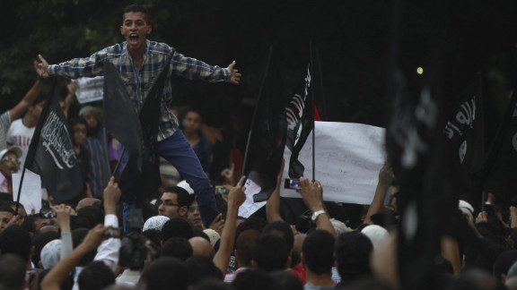 People shout in front of the U.S. Embassy in Cairo.