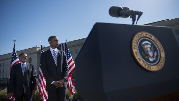 U.S. Defense Secretary Leon Panetta, left, and President Barack Obama stand during a memorial service at the Pentagon in Washington. Obama attended the memorial service, near where American Airlines flight 77 crashed into the Pentagon, to honor the victims of the September 11 attacks.